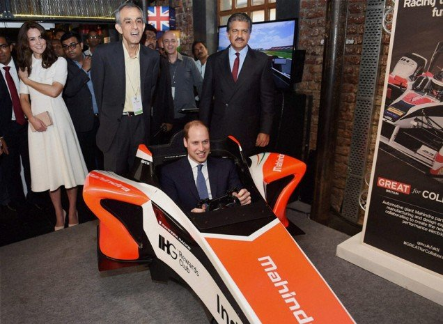 Mumbai: Prince William, Duke of Cambridge sits in a car simulator as Catherine, Duchess of Cambridge watches him during the launch of 'Tech Rocketship Awards' in Mumbai on Monday. PTI Photo by Shashank Parade(PTI4_11_2016_000068A)