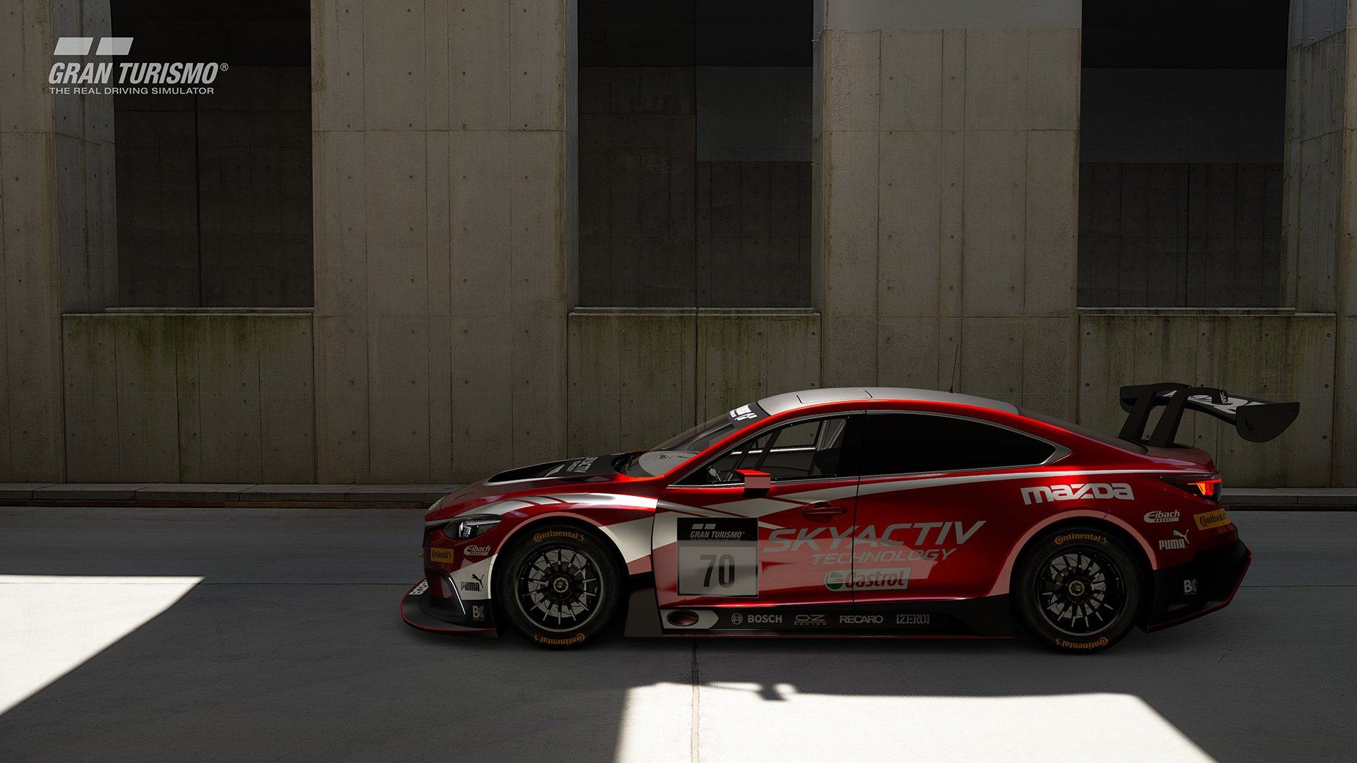 Gran Turismo Sport Mazda GT4 in front of wall